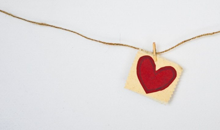 Cloth heart pinned to a cord. Our hearts are limited in their movement today.