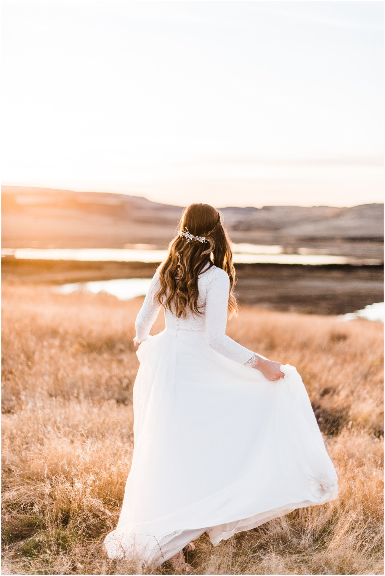 Photo of a Bride twirling in a meadow sunset by Forthright Photo