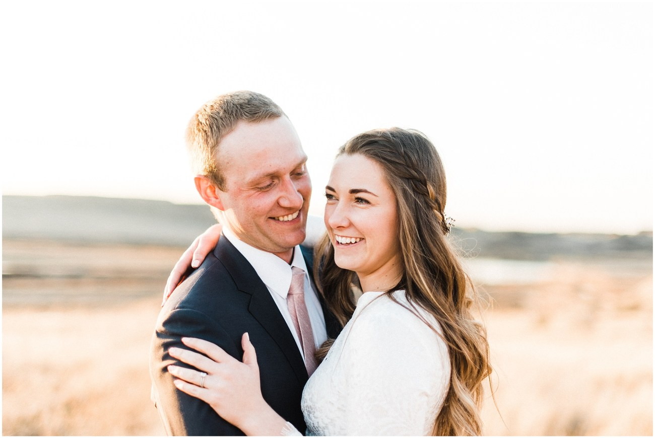 Close Up photo of a bride and groom in a meadow at sunset by Forthright Photo
