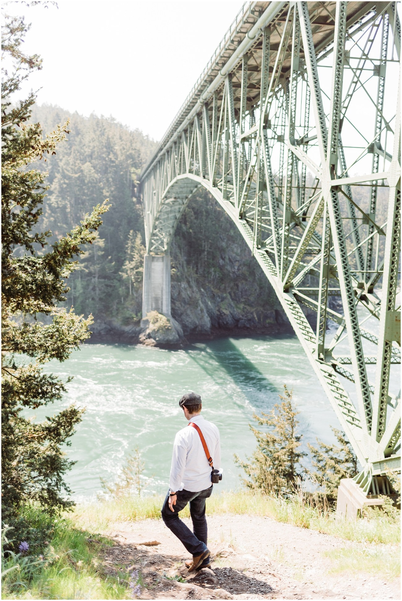 Photo of Devon in front of Deception Pass Bridge in Deception Pass State Park by Forthright Photo