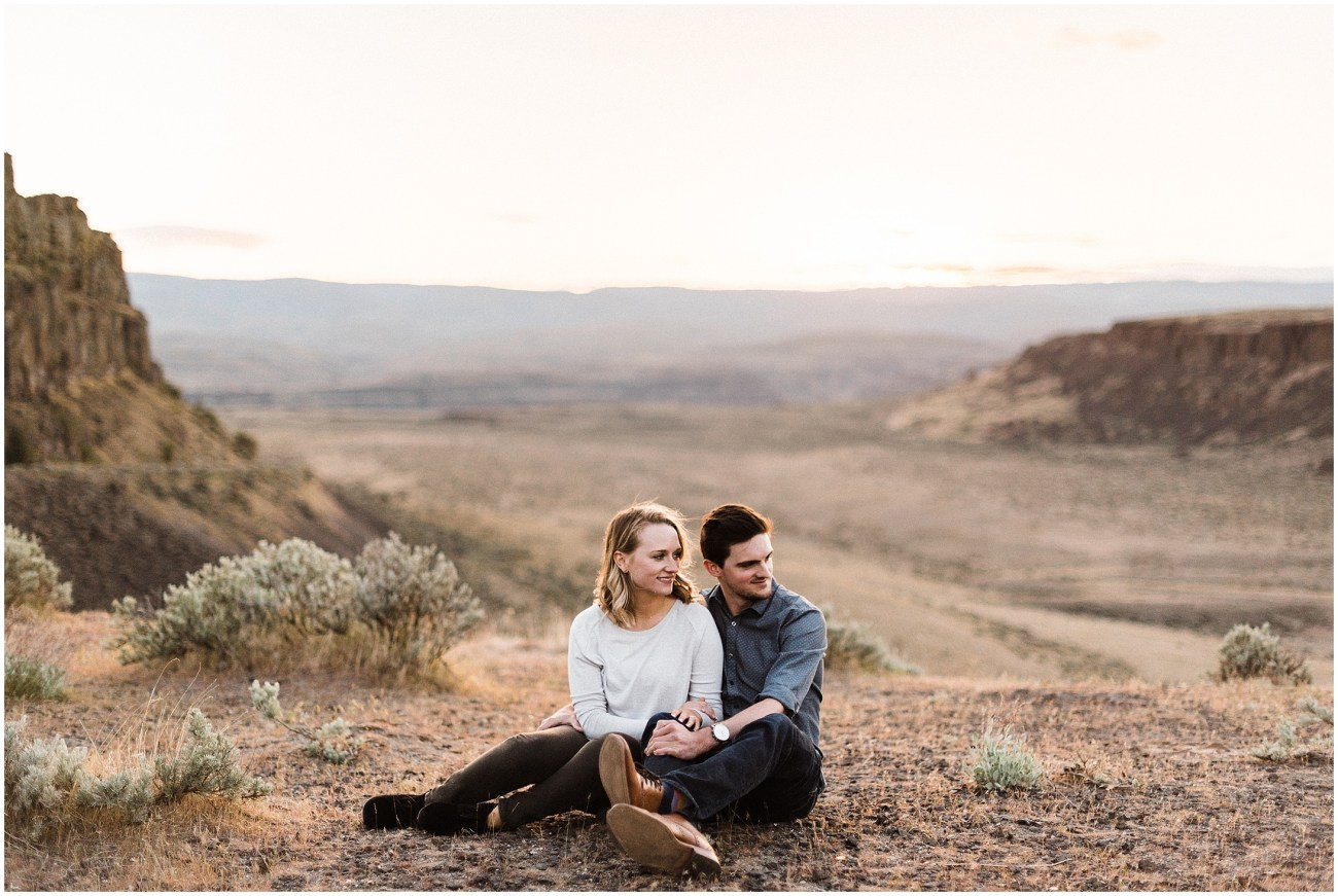 Photo of an engaged couple in Frenchman Coulee Recreation Area at sunset by Forthright Photo