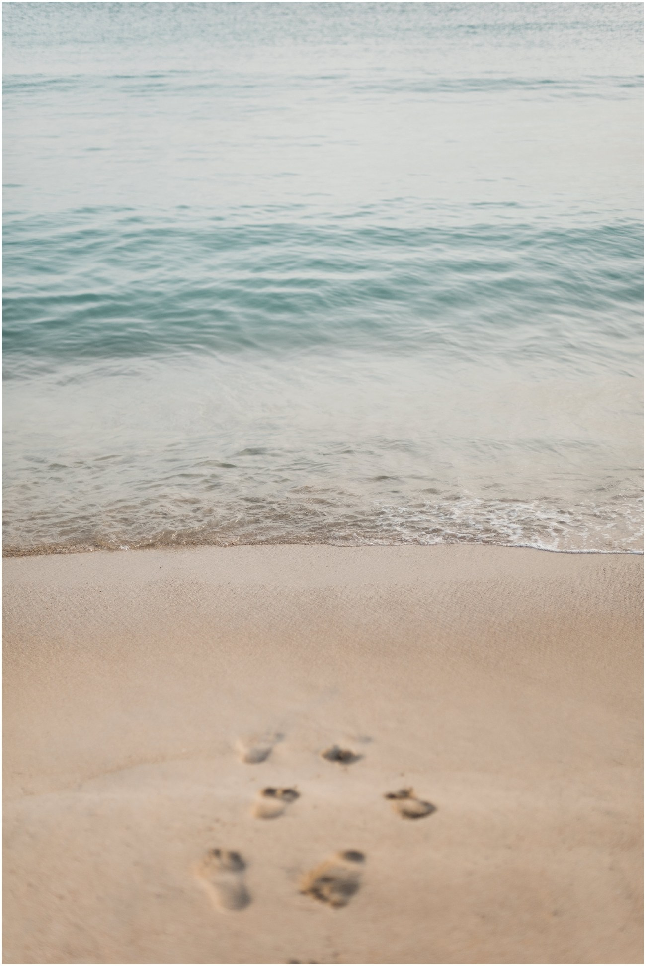 Photo of footprints on a beach in the USVI