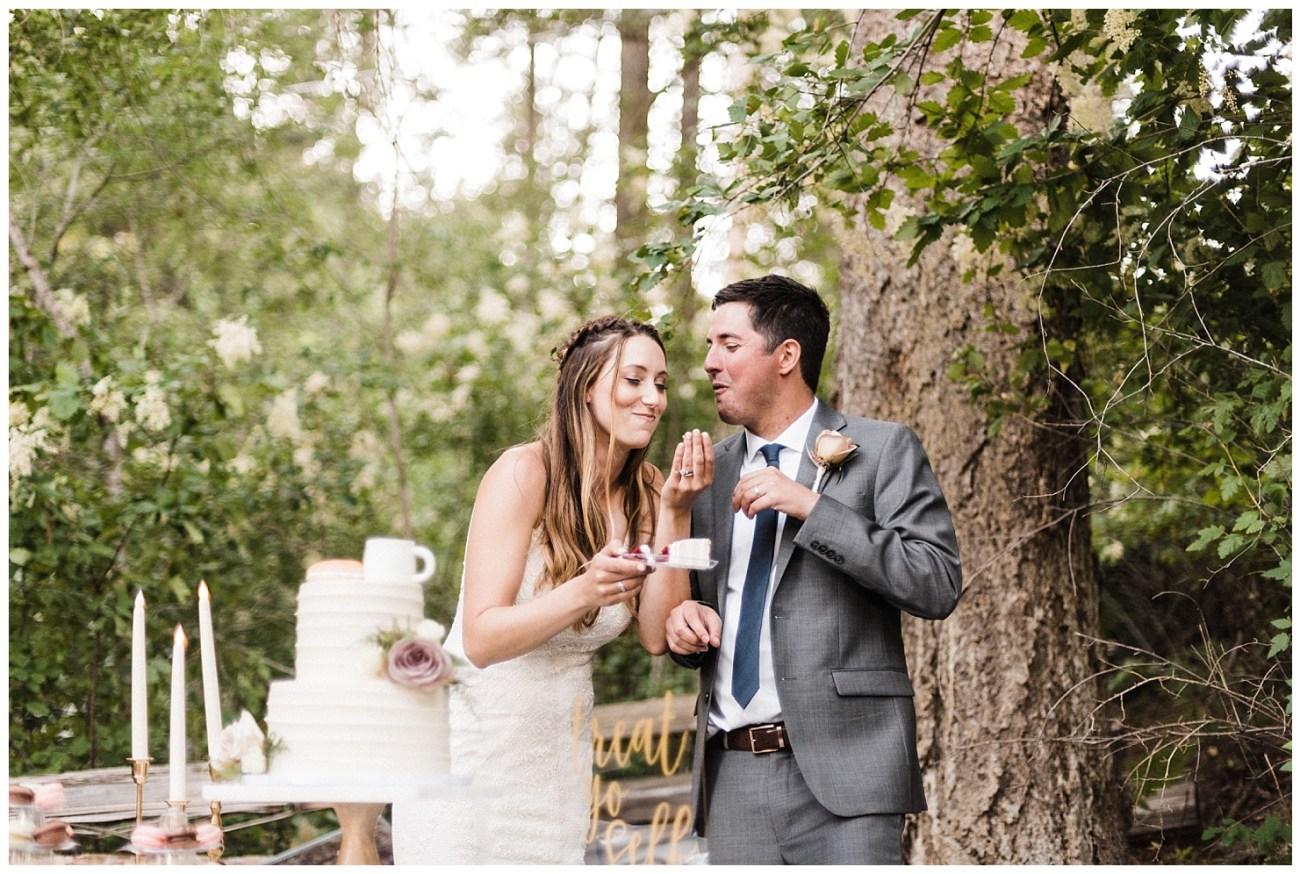 Bride & Groom eating cake at their Lake Coeur d'Alene Wedding Reception