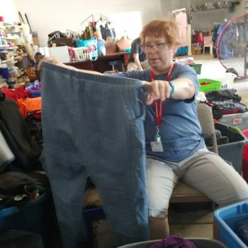 Sorting Donated Clothing at Drug Abuse Center