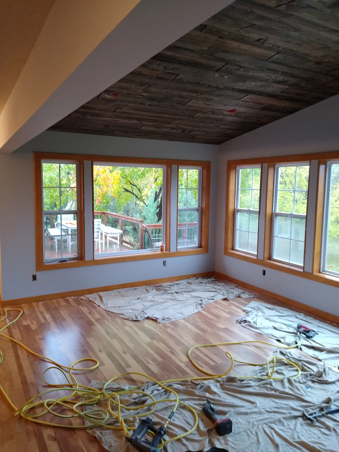 Addition with wood floor and paneled ceiling