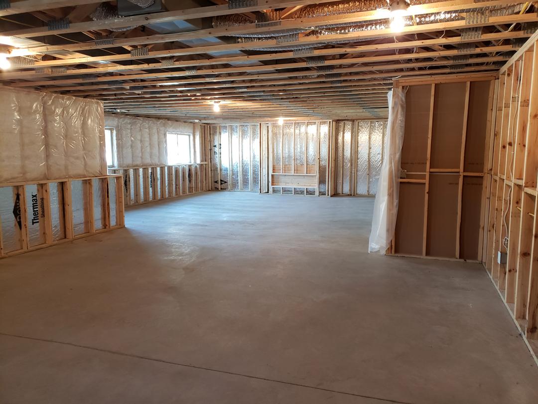 framed basement with concrete floor