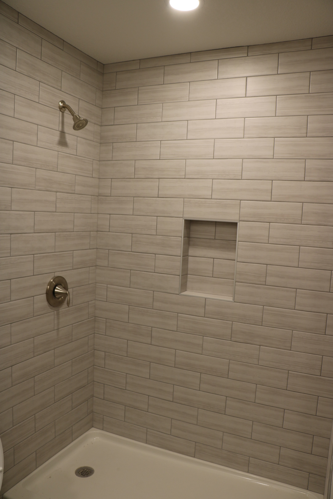 new shower with subway tile