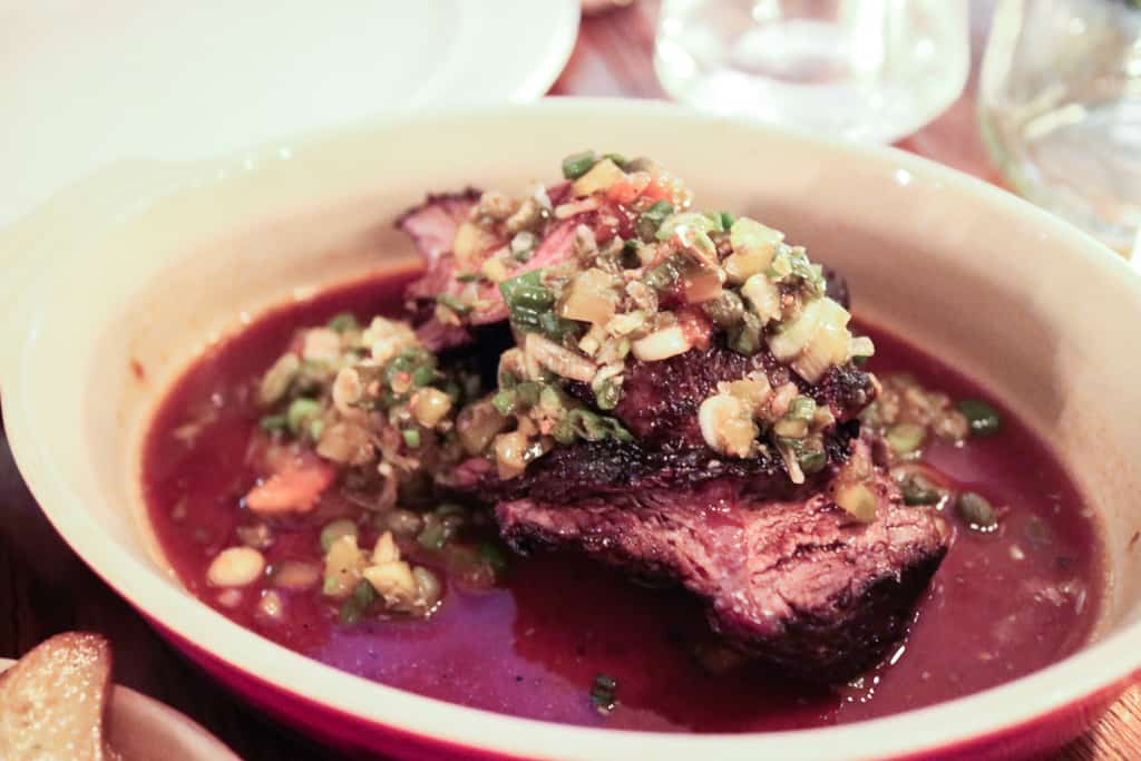 Grilled hanger steak with wild leek relish from Ruby Watchco Toronto