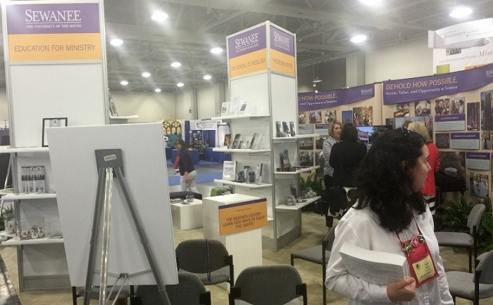Hope Benko passes by the Education for Ministry booth