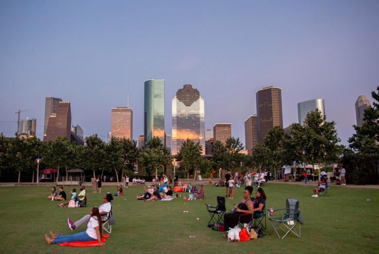 Families gather at Buffalo Bayou Park to listen to the Freedmen's Town Mass Choir during the Juneteenth Worship Experience on June 12, 2021.