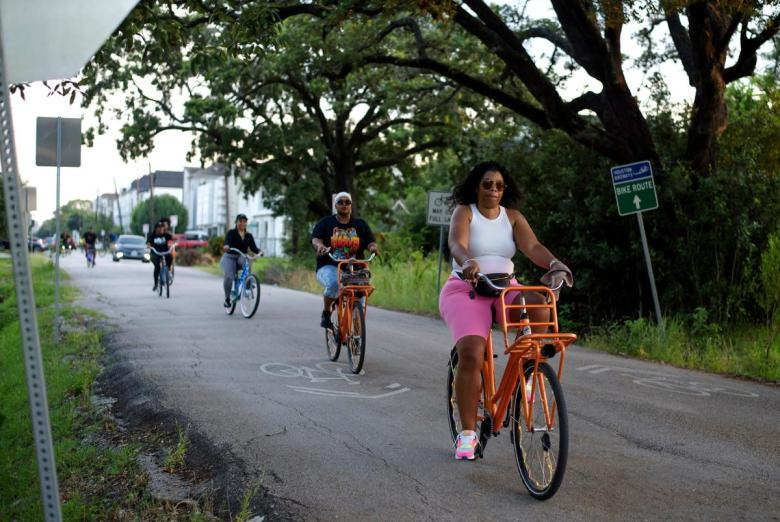 Bike riders listen to instructions before a Juneteenth bike ride in Houston, Texas.