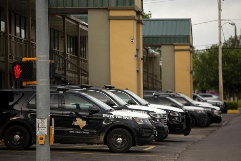 Numerous Texas Department of Public Safety vehicles are parked at a Best Western hotel in Del Rio on July 23, 2021.