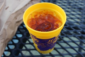 A photo of a cup of Omega Oil from the Let the Good Times Roll Festival