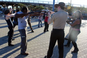 KIDS THESE DAYS: About a dozen of the kids who dressed as characters from The Walking Dead faced off with water pistols at the 2012 Shreveport Zombie Walk. Shouldn't someone be out looking for Carl?!