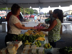 A photo of a farmers market vendor