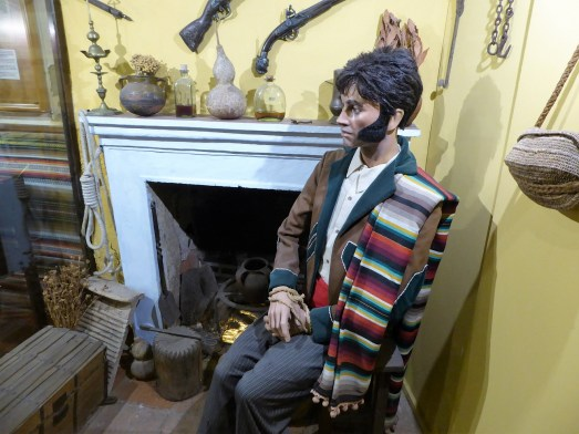 A diorama of a kidnapping. Seriously, it's worth the price of admission for the muttonchops on this guy. Photo by T.