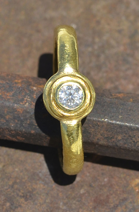 single diamond with 24k accent ring