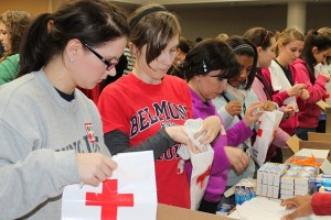 Students stuff emergency kits at Red Cross during the MLK Joint Day of Service in 2012.