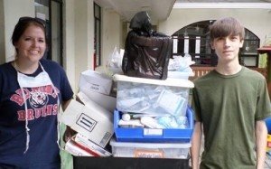 Second-year pharmacy student Kandice Squires and incoming freshman Will Hobson move medical supplies.