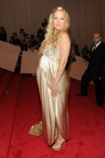 Kate Hudson, in Stella McCartney, with Fred Leighton jewels, an Edie Parker clutch, and Casadei shoes.