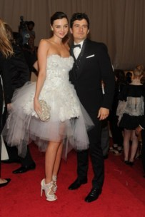 Miranda Kerr, in Marchesa, with Harry Winston jewels and Nicholas Kirkwood shoes; with Orlando Bloom.