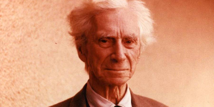 Portrait of Bertrand Russell in front of orange background