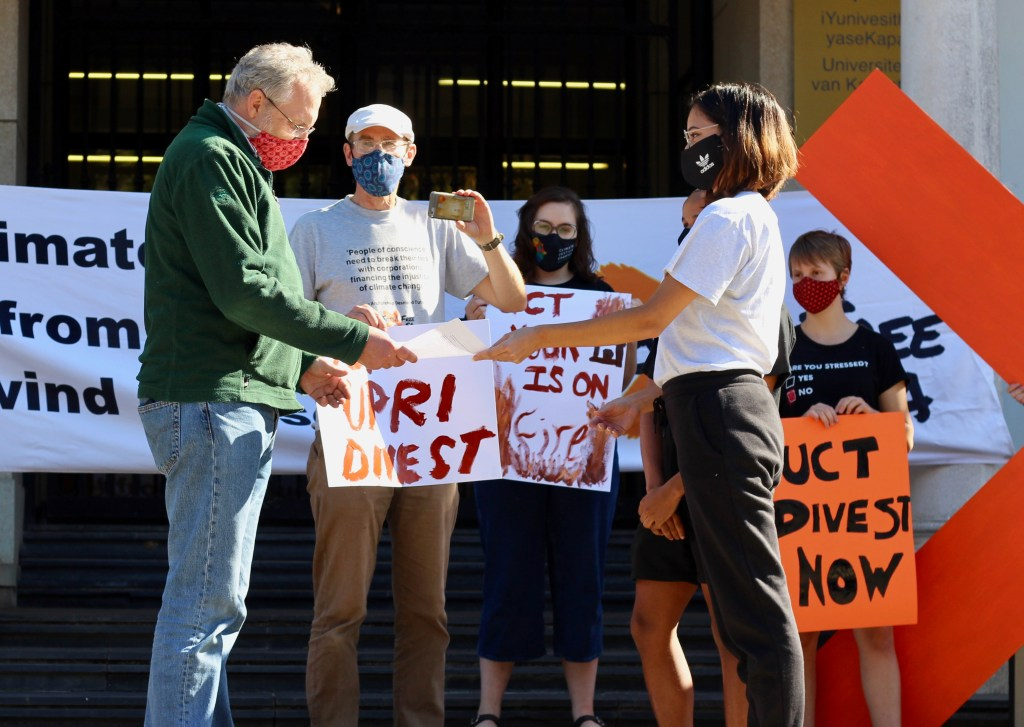 UPRI chair Professor Tom Moultirie accepts a memorandum from students of the UCT Green Campus Initiative and Fossil Free UCT campaign in May 2021.