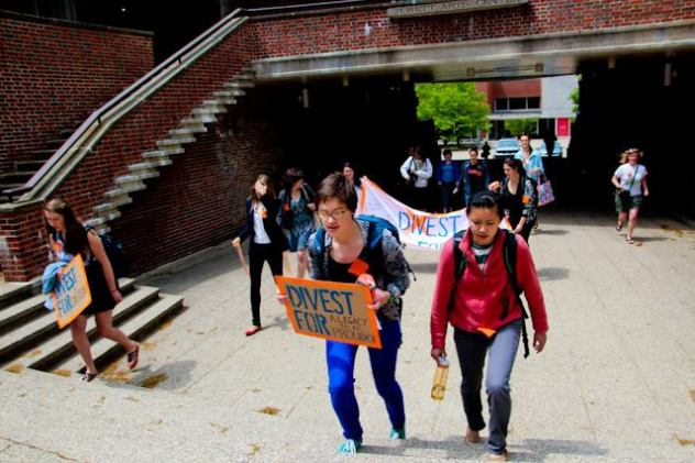 Students march up to President Bottomly's office