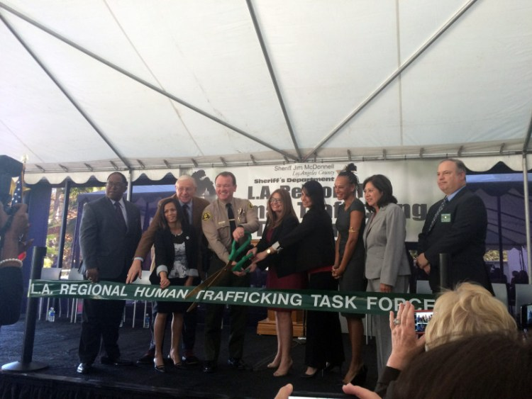 The ceremonial ribbon-cutting at the kickoff for the new multi-agency Los Angeles Human Trafficking Task Force.