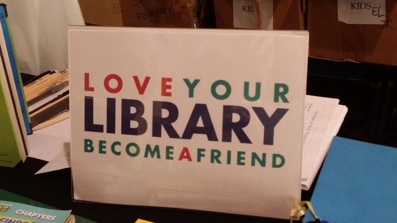 sign saying love your library become a friend