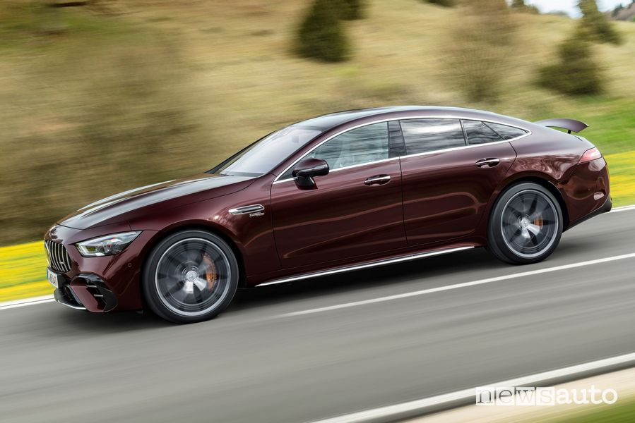 Mercedes-AMG GT Coupé 53 4MATIC + side view on the road