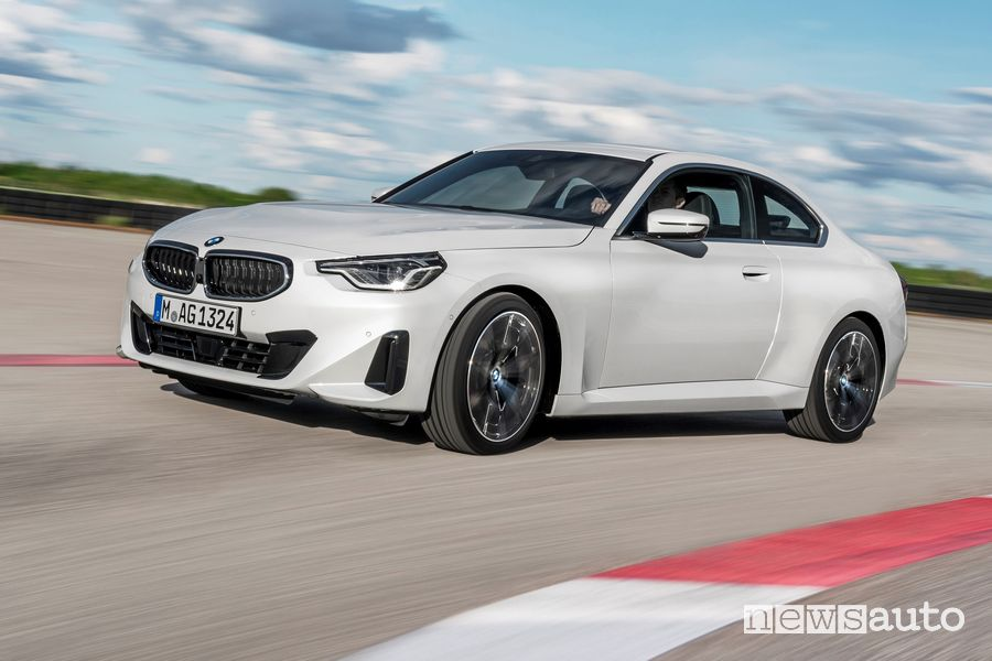 Profile view of the new BMW 2 Series 220i Coupe on the track