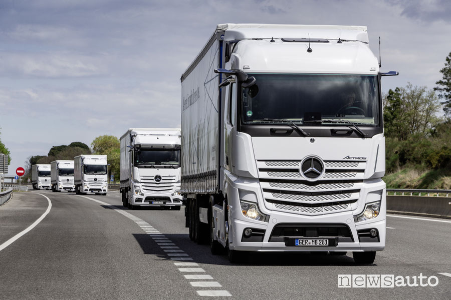 White Mercedes Actros truck in single file on highway