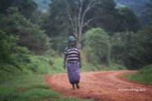 A Lady in Solitaire. Location: Uganda