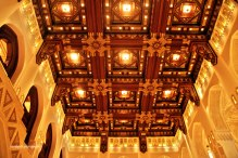 Instead of covered by paintings, the ceiling are covered by wooden craft