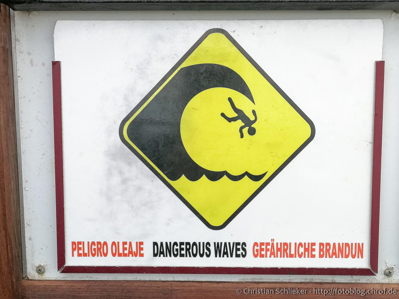 Warnwchild mit Welle und fliegendem Mänchen