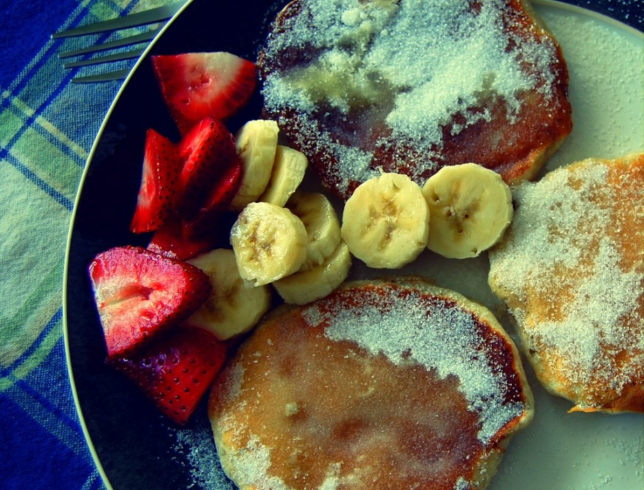 banana walnut pancakes with butter and sugar
