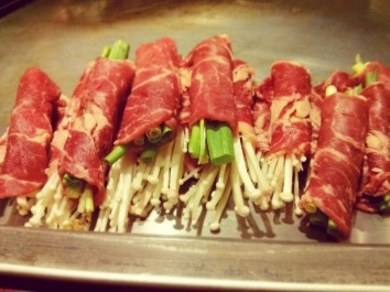 green onion and enoki mushrooms wrapped in beef