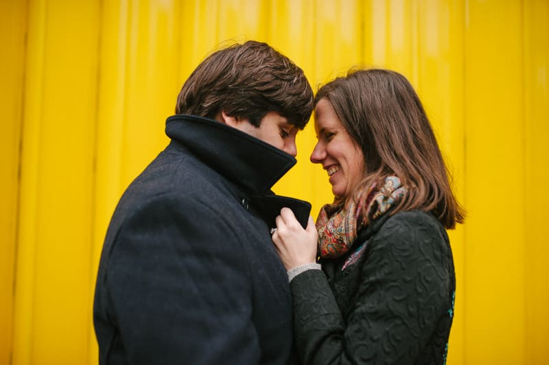 Creative portrait of couple yellow background