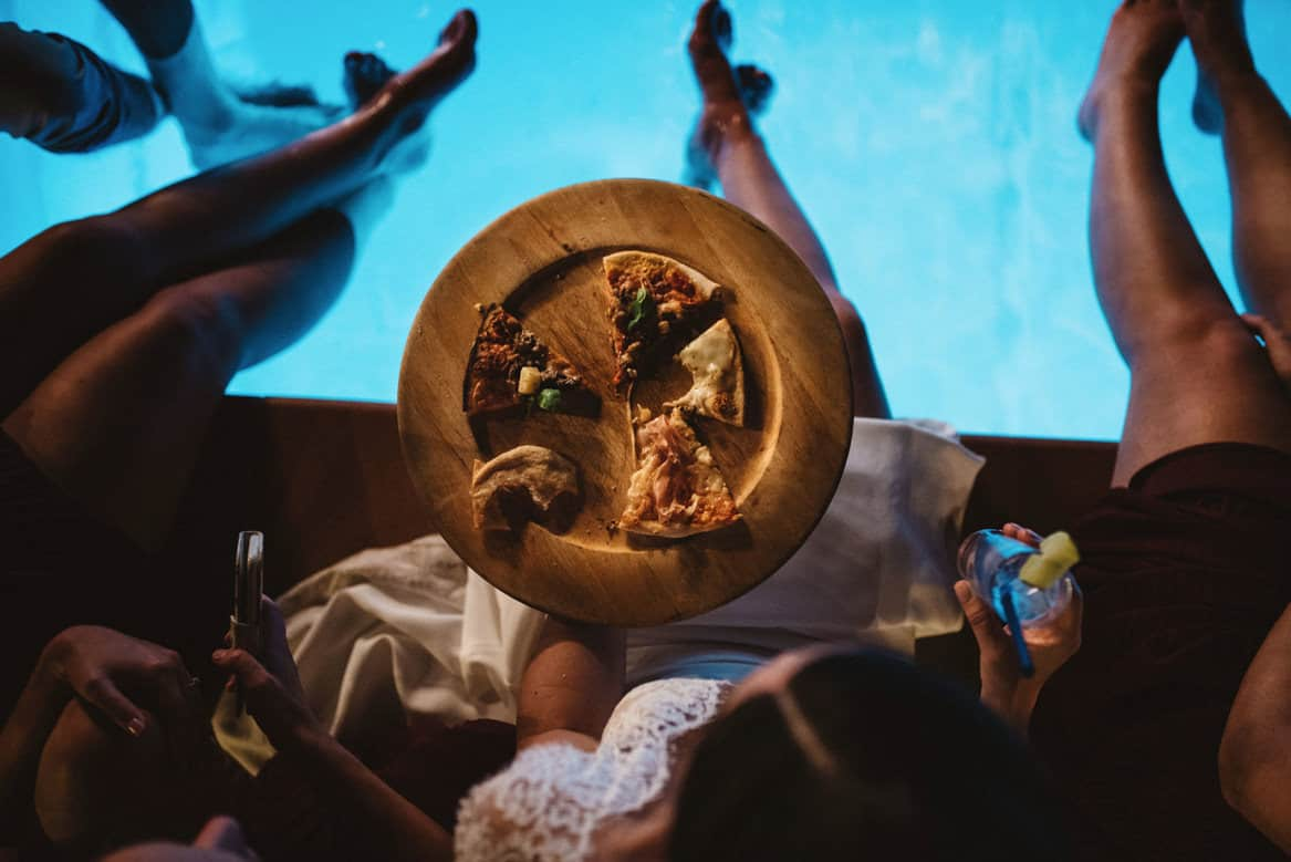 pizza by the pool during Villa di Ulignano wedding