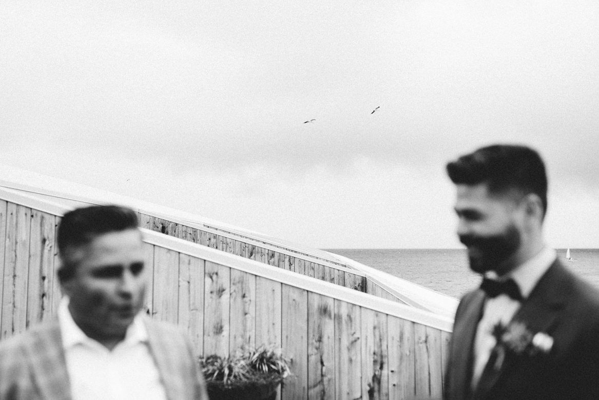 Boutonnière groom and best man having drinks on a balcony maq01 hotel hobart