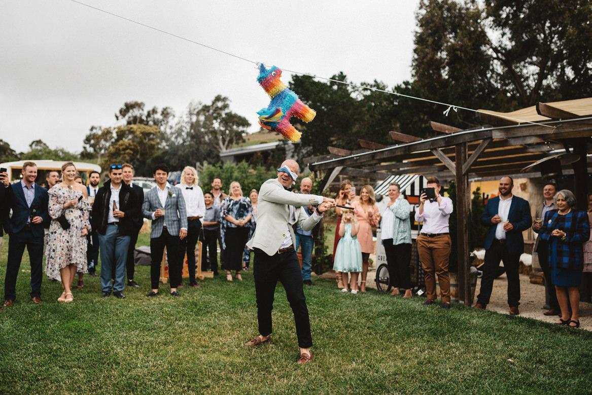 tasmania wedding photographer piñata blindfold mexican theme