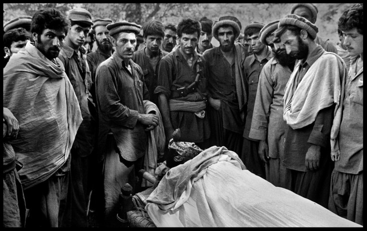 AFGHANISTAN, 1980. Men pay their respects.