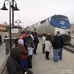 The late-arriving Southwest Chief rumbles into Albuquerque as passengers huddle against the cold wind. © William P. Diven.