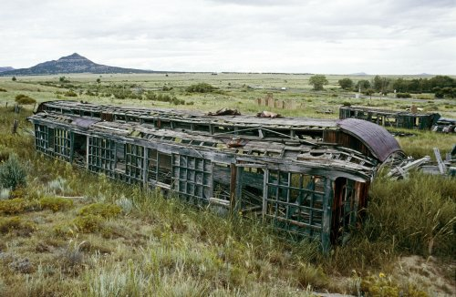 Derelict passenger and freight cars mark the site of Colfax, N.M., once the junction of two railroads.