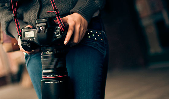 reflex camera in hand