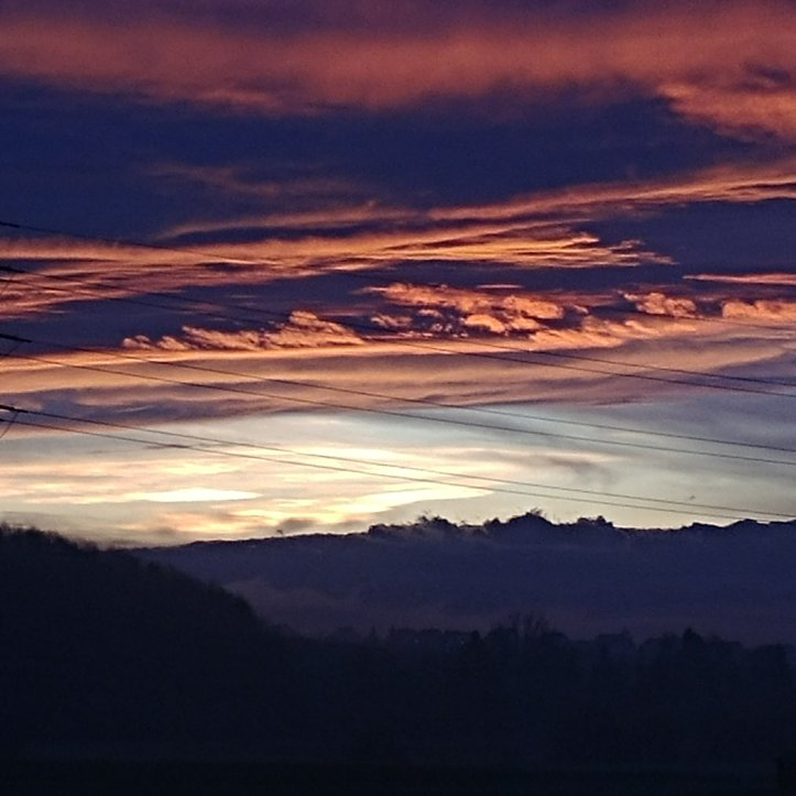 Colorful clouds over the Swiss Mountains