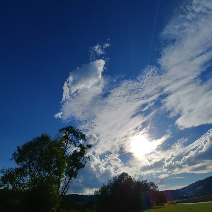 Clouds and sun in blue sky, nature photography blog by fotosbykarin