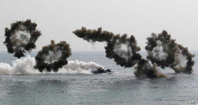 South Korean marine's amphibious assault vehicles sail to shores in a smoke screen for landing during the U.S.-South Korea joint landing military exercises as a part of the annual joint military exercise Foal Eagle between South Korea and the United