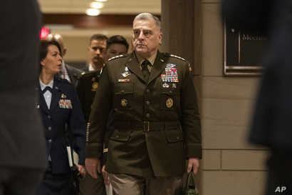 Joint Chiefs of Staff Chairman Gen. Mark Milley arrives to conduct briefings for members of Congress on last week's targeted…